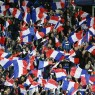 epa05023718 French soccer fans wave flags during the international friendly soccer match between France and Germany at the Stade de France stadium in Saint-Denis, near Paris, France, 13 November 2015.  EPA/IAN LANGSDON